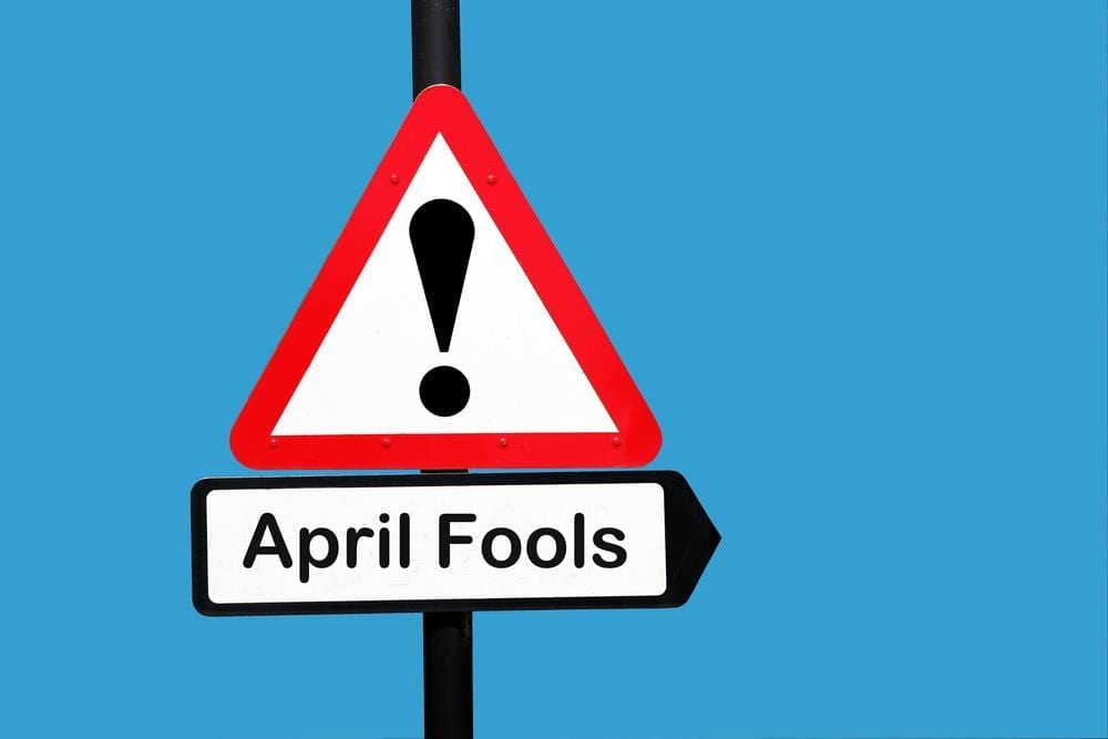april fools road sign on blue background
